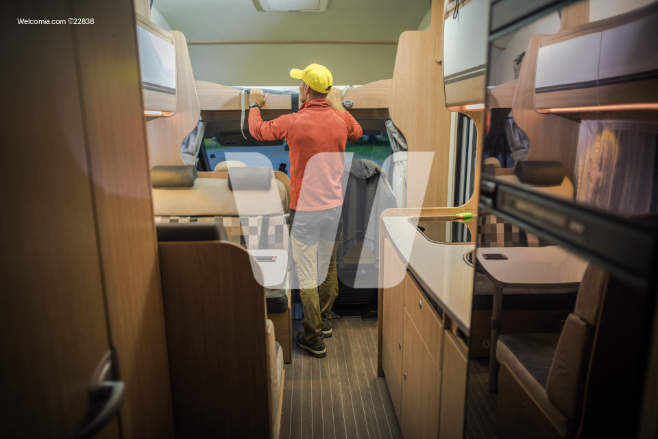 Men Preparing RV For Season