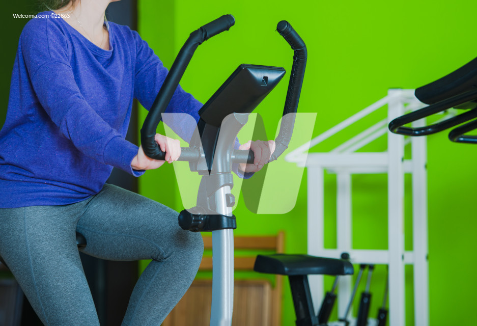 Woman Excercising On Stationary Bike.