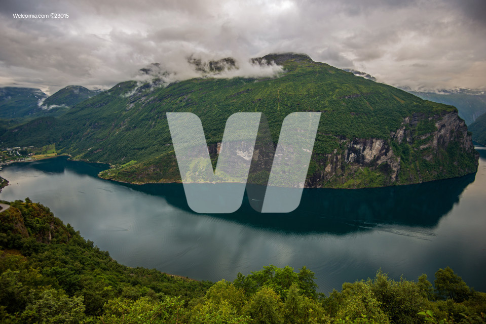 Aerial View Of  Geiranger Village And Nearby Natural Wonders.