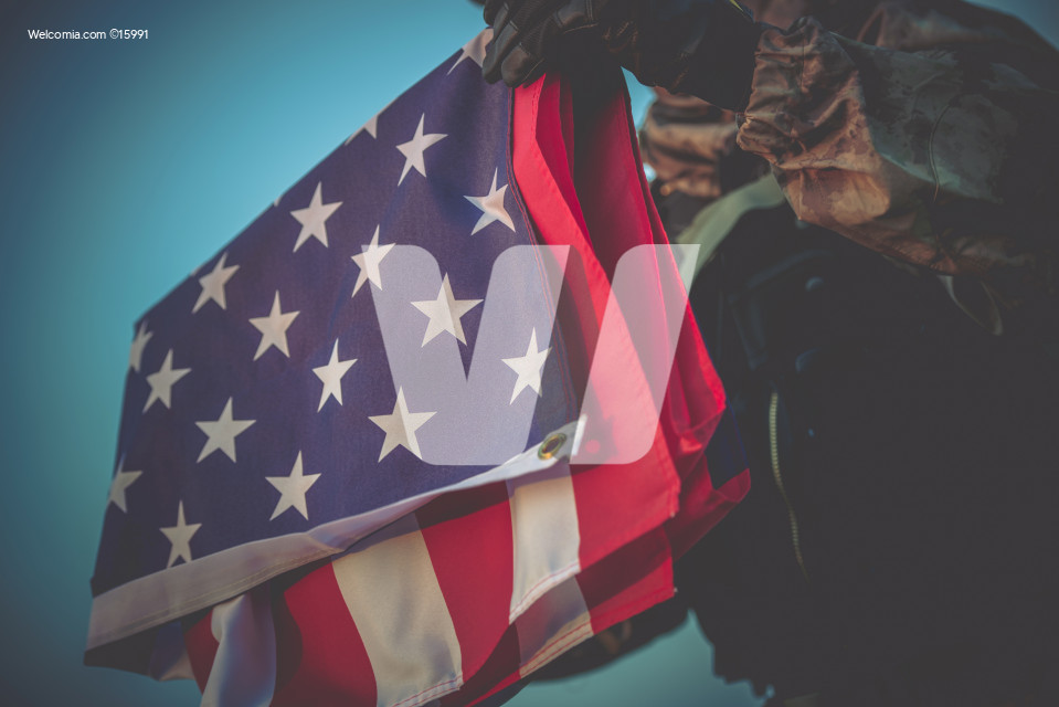 American Flag in Soldier Hands