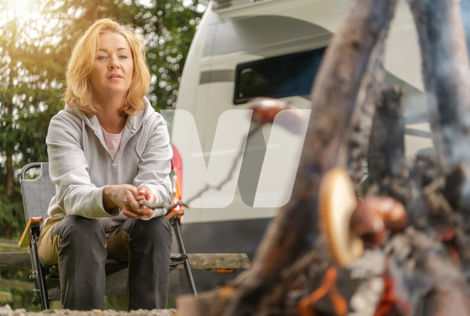Campfire Polish Sausage Grilling by Caucasian Woman