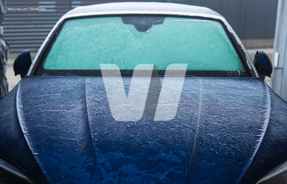 Car Covered in Frost During Cold Winter Morning