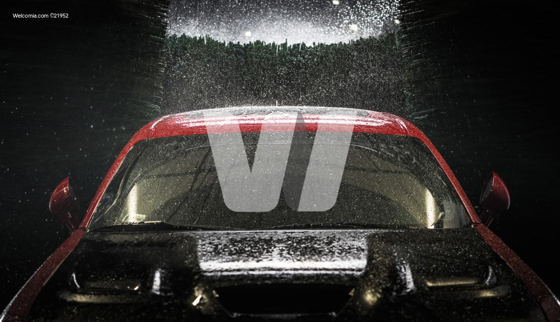 Car in a Car Wash at Night