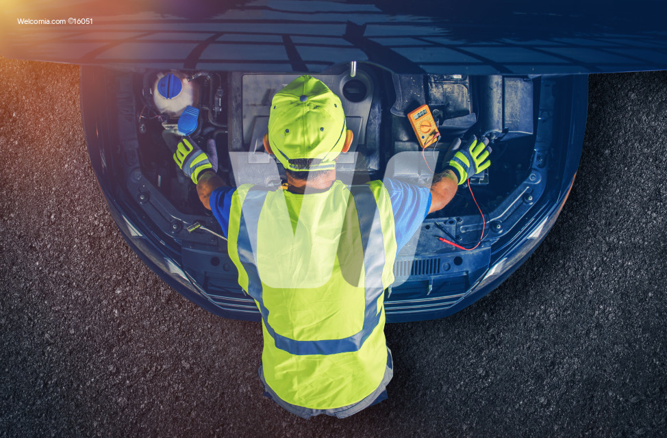 Car Mechanic Servicing Vehicle