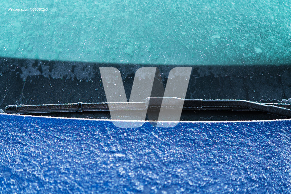 Car Windshield Wipers in Freezing Winter Condition