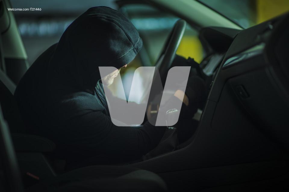 Caucasian Car Thief in Action