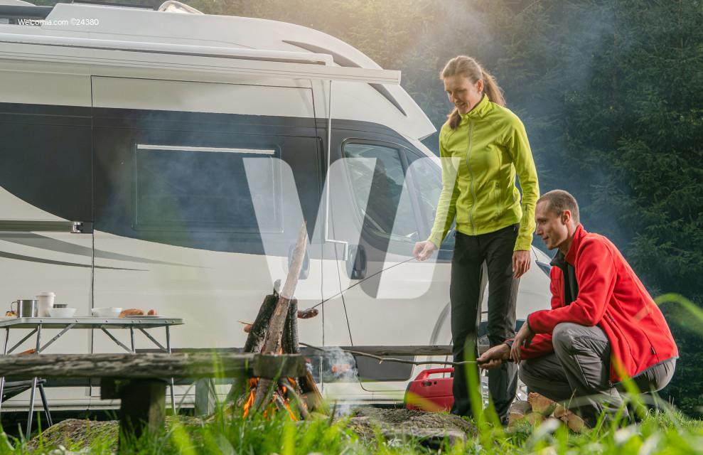 Caucasian Couple RV Park Campfire Fun