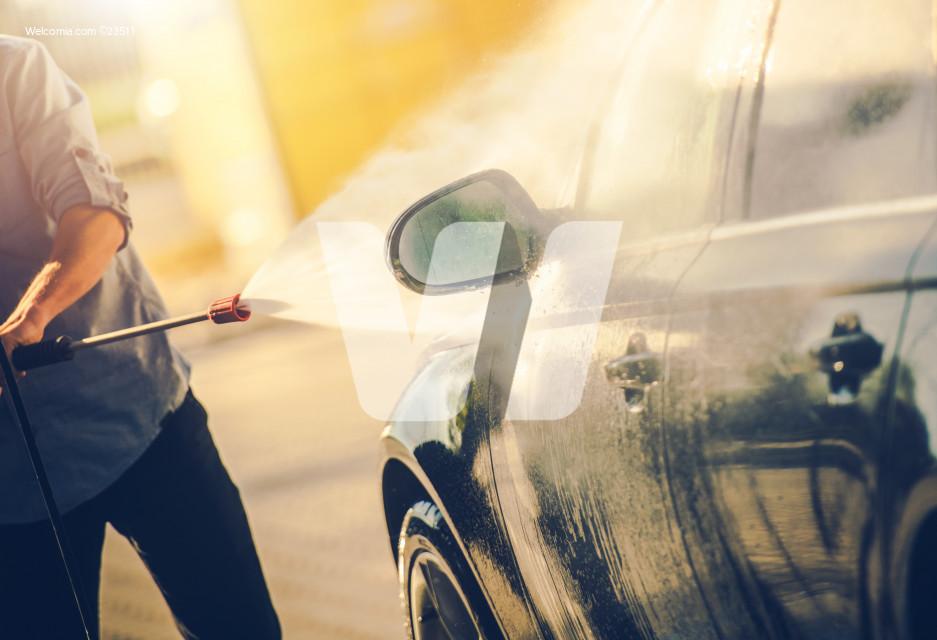 Caucasian Men Washing His Modern Car