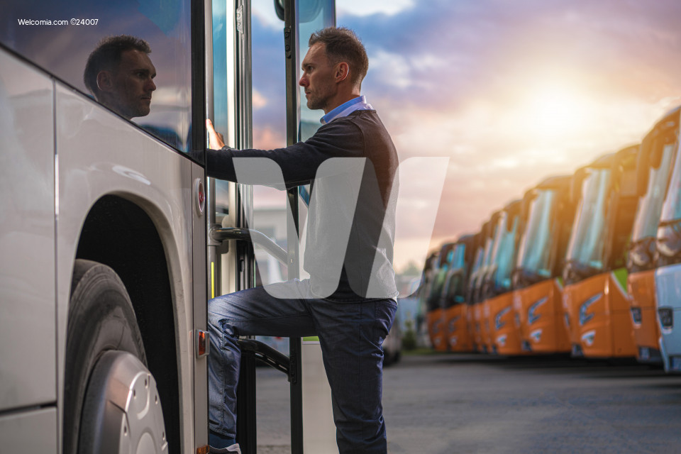 Caucasian Passenger Getting Into Public Shuttle Bus