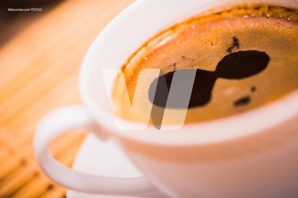 Small White Ceramic Coffee Cup Closeup.