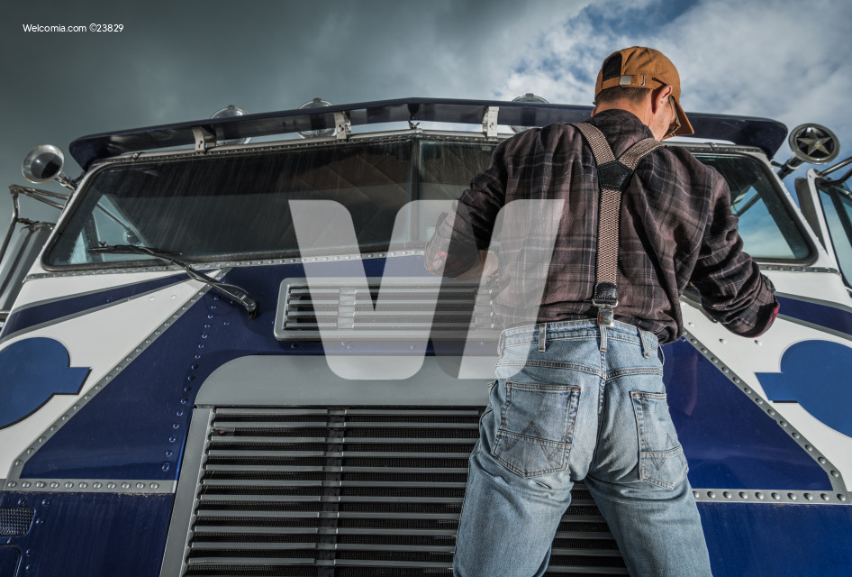 Commercial Driver Checking Truck Windshield Wipers in His Vehicle
