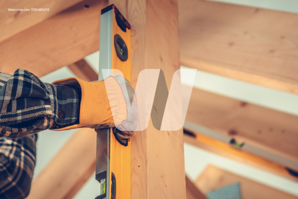 Construction Contractor Checking Home Frame Levels