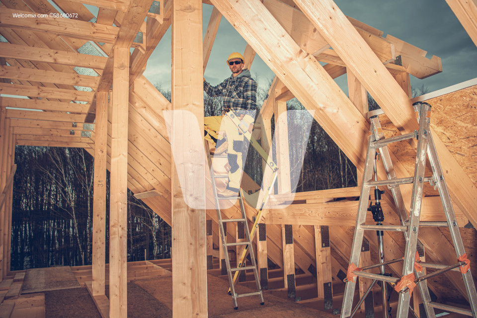 Construction Worker Building Wooden House Frame