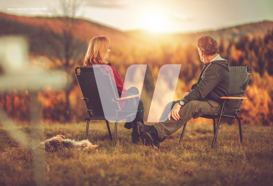 Couple Enjoying Scenic Vista From Their Camping Chairs