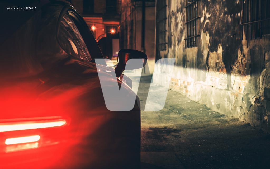 Exotic Car Night Drive in Dark Aged Urban Area Alley