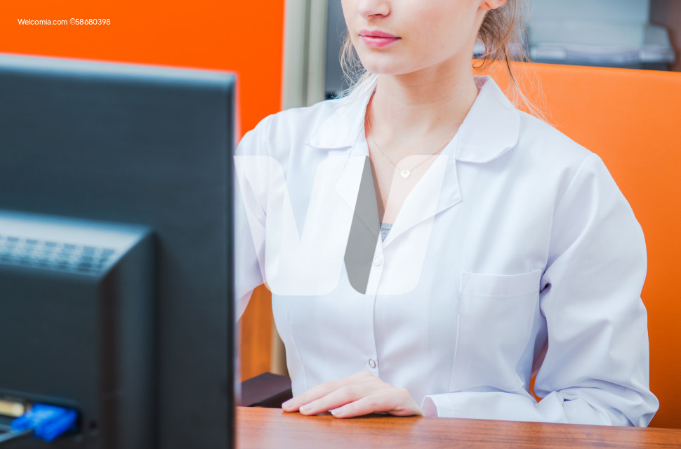 Female Hospital Doctor in Front of Her Office Computer