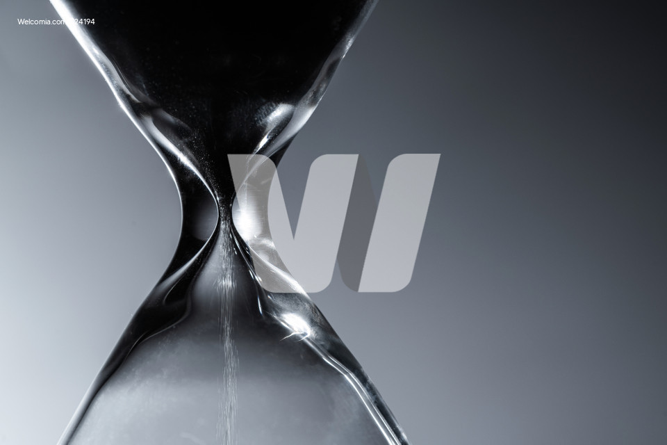 Hourglass Countdown in a Dark Close Up