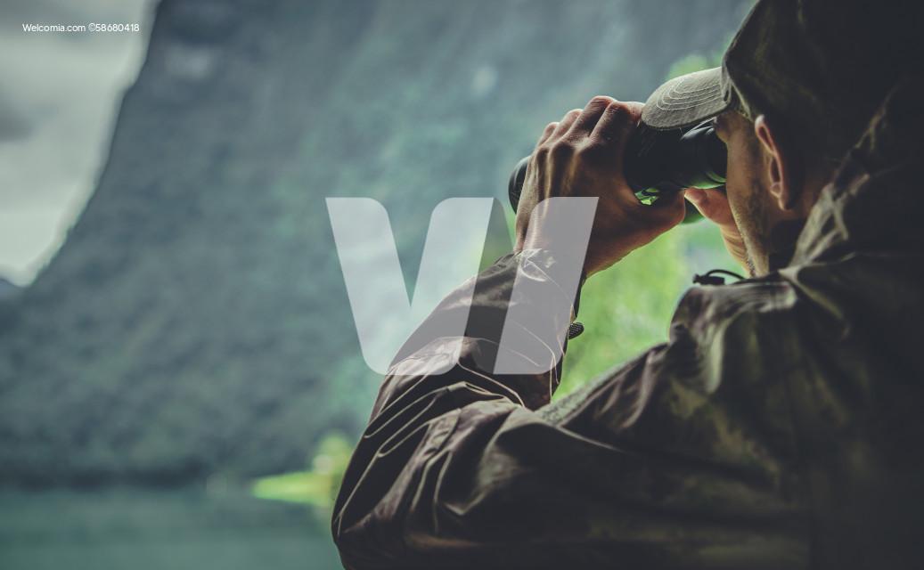 Hunter in Camouflage Uniform Spotting Game