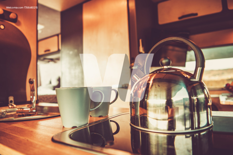 Kettle and Two Cups with Hot Tea Inside RV Camper Van