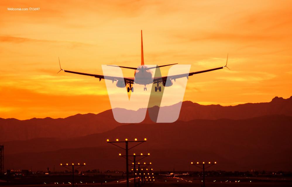 Landing Airplane at Sunset
