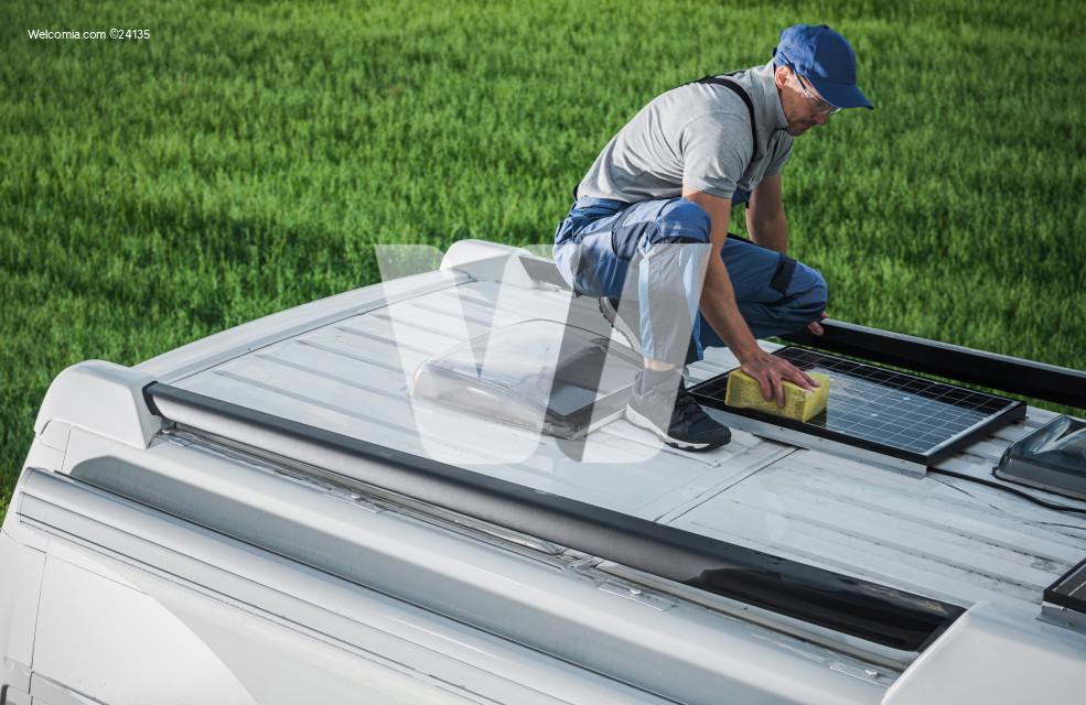 Men Cleaning Camper Van RV Roof Installed Solar Panels