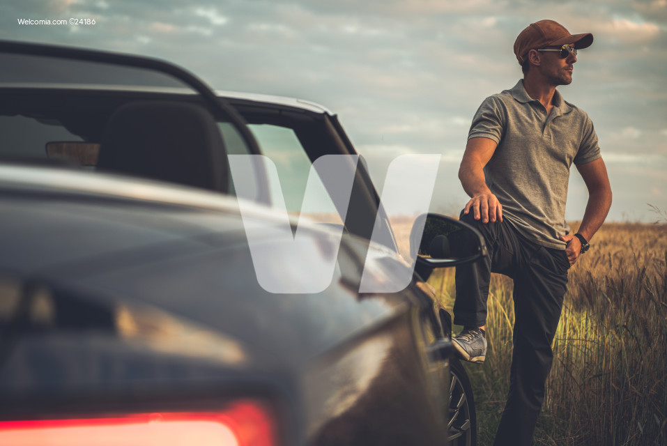 Men Enjoying His Countryside Road Trip in Cabriolet Vehicle