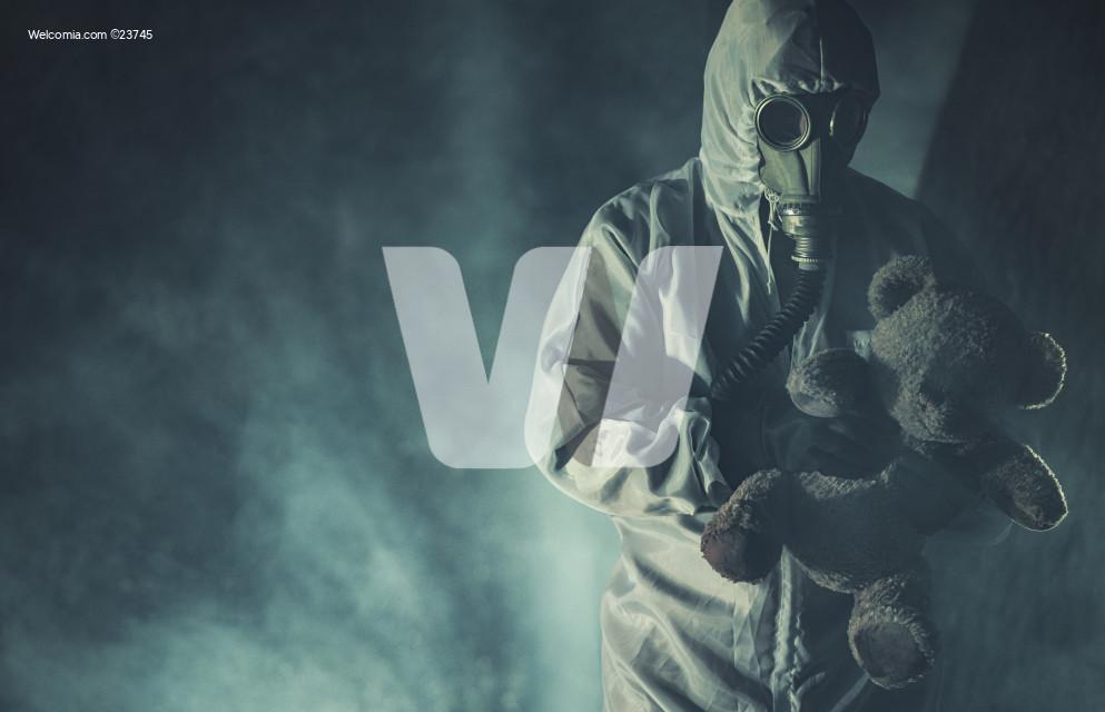 Men in Biohazard Mask and Hazmat Suit with Teddy Bear.