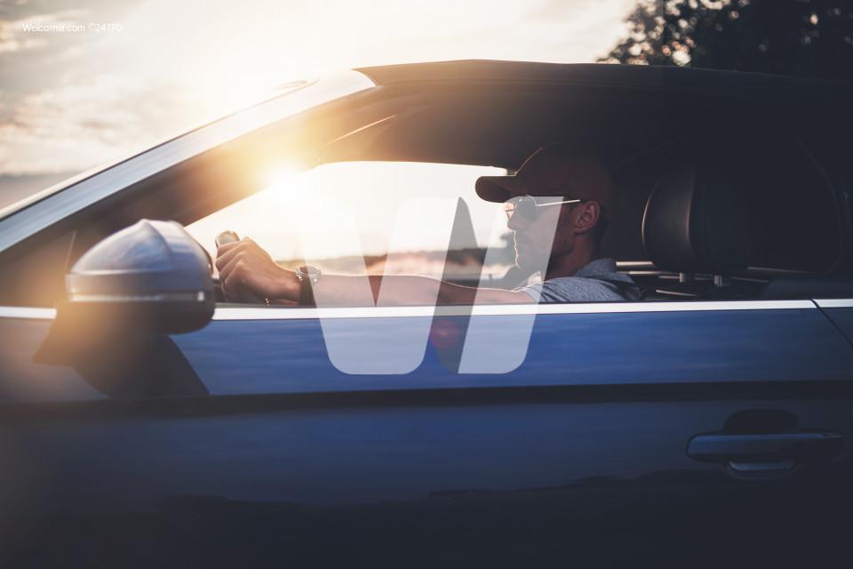 Men in His 40s Enjoying Drive in His Convertible Car