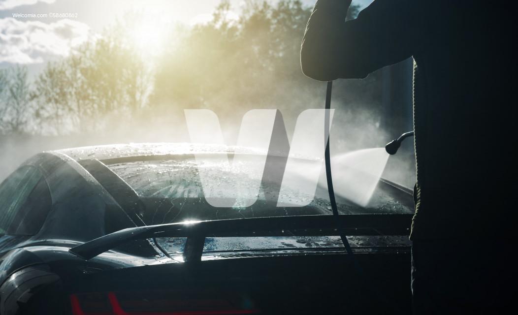 Men Pressure Washing His Performance Exotic Car
