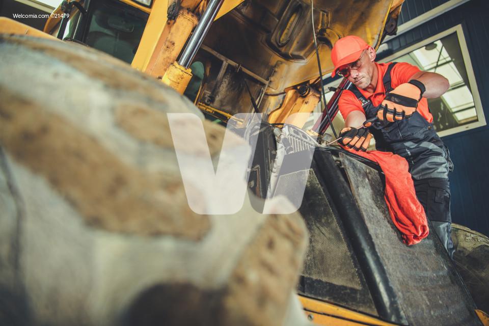 Men Repairing Small Dozer