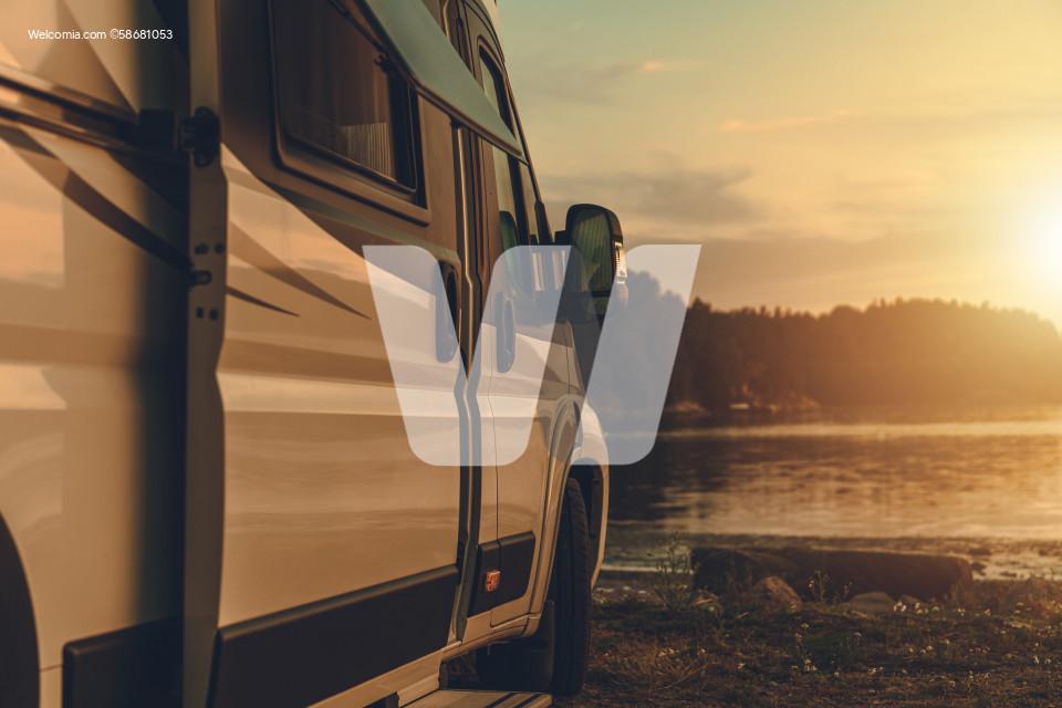 Motorhome Camper Van Camping Next to the Bay at Sunset