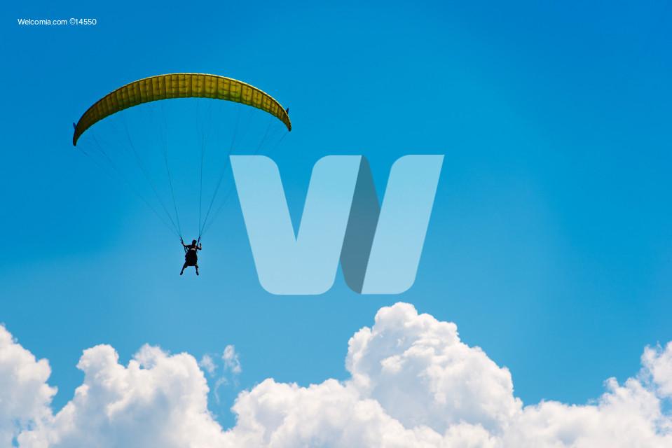 Parachute Over Blue Sky