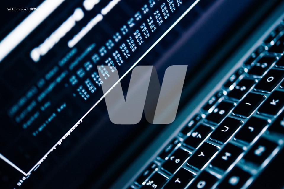 Password Hacking Concept Photo. Laptop Computer and Password Hacking Algorithm on the Computer Screen