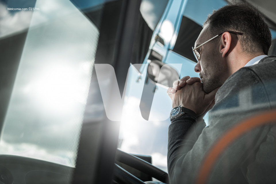 Pensive Bus Coach Driver Behind Vehicle Wheel