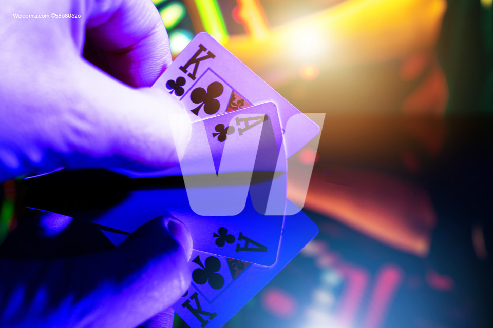 Poker Player with Two Cards in His Hands