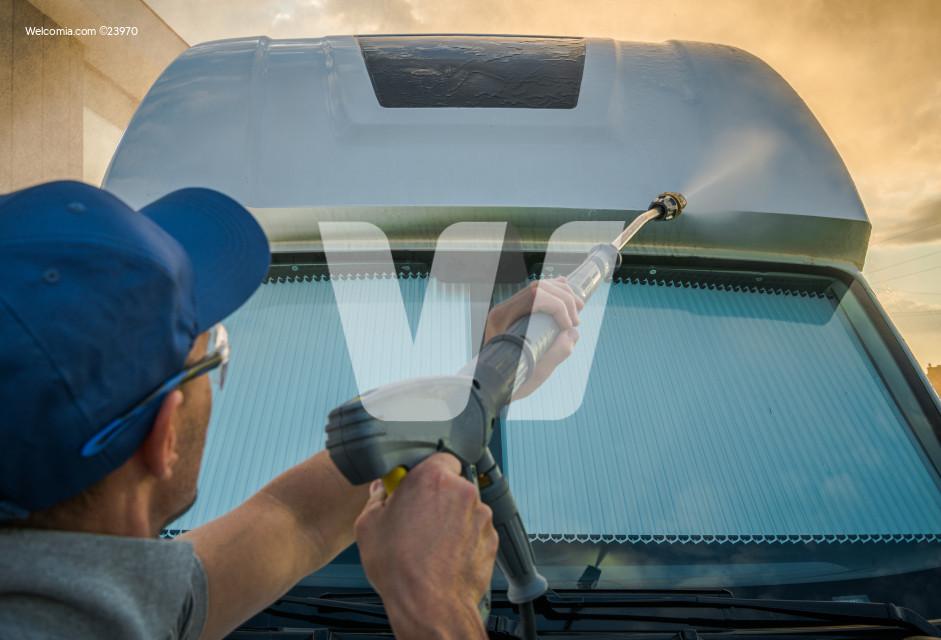 Pressure Washing Front of Modern RV Recreational Vehicle