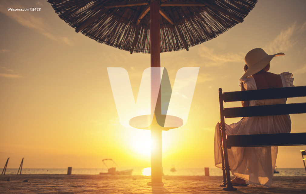 Retired Caucasian Woman Enjoying Tropical Beach Sunset