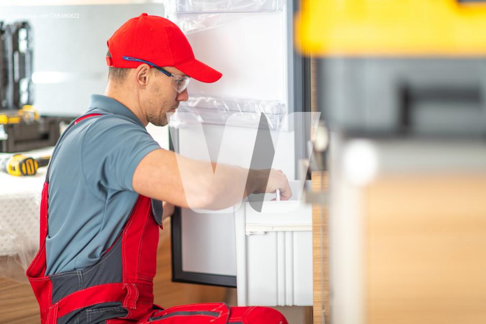 RV Center Technician Replacing Broken Motorhome Refrigerator