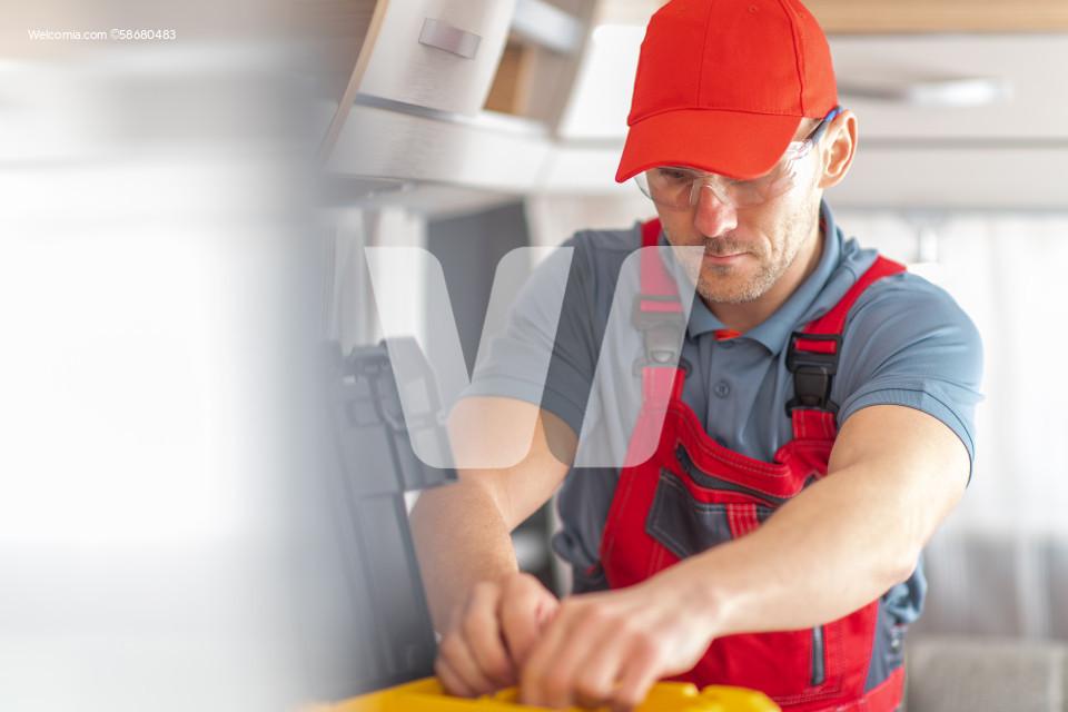 RV Industry Technician Inside Modern Travel Trailer