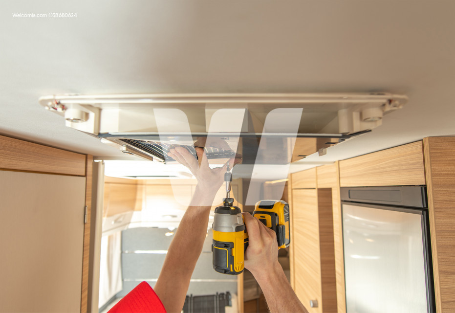 RV Technician Worker Replacing Air Conditioner Unit Inside Motorhome