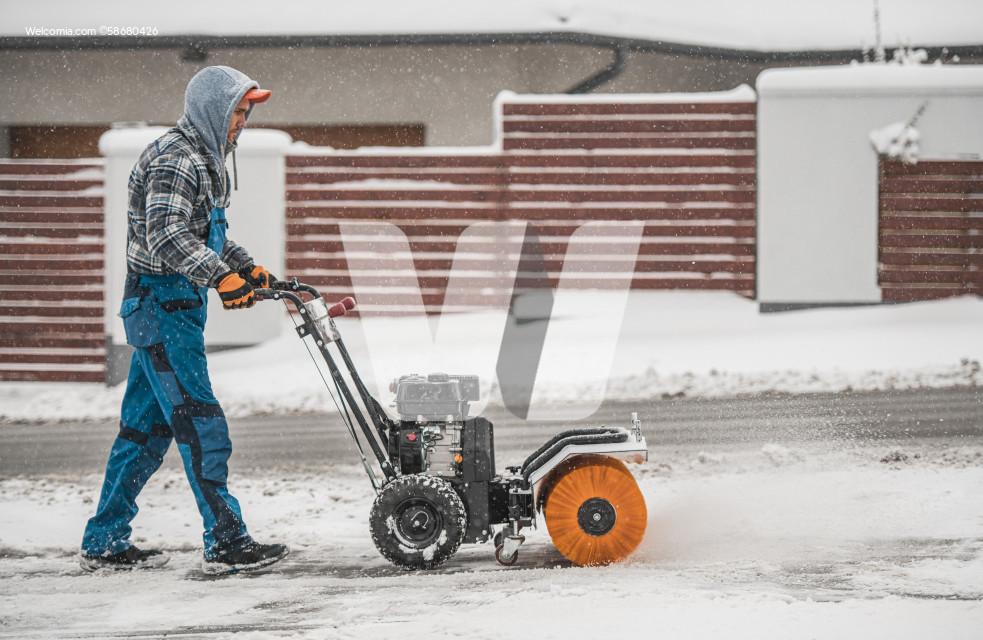 Snow Removal Using Power Broom