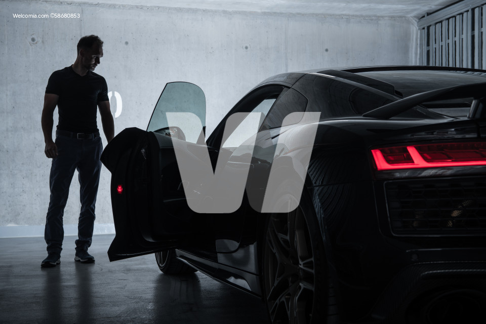 Successful Men Looking at His Luxury Exotic Car