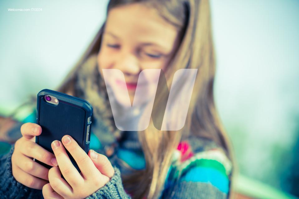 Teenage Playing Smartphone