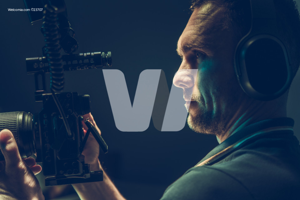 Videographer Camera Operator with Professional Digital Recording Device in Hands