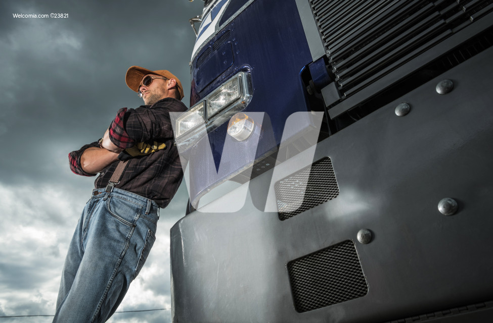 Vintage Semi Truck Driver in Front of His Vehicle