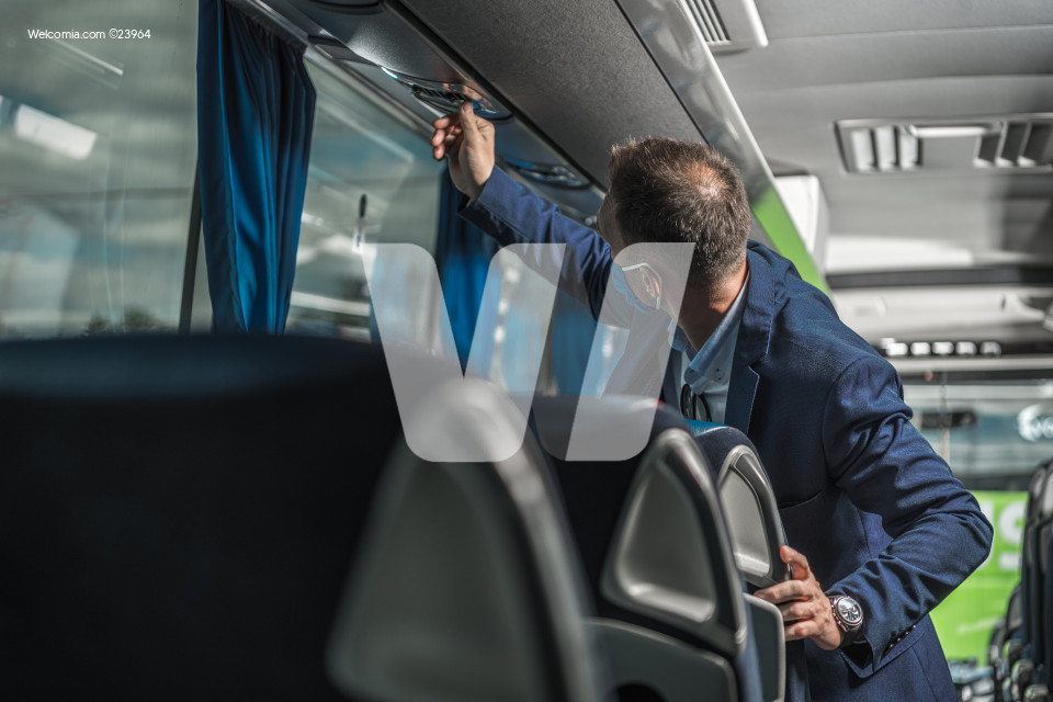Shuttle Driver Checking Air Conditioning System In Bus.