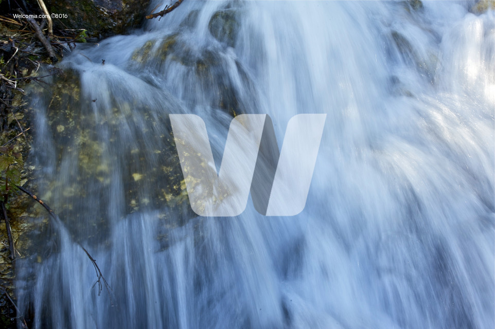 Waterfalls Closeup. Rapidly Running mountain Stream Water. Nature Photo Collection.