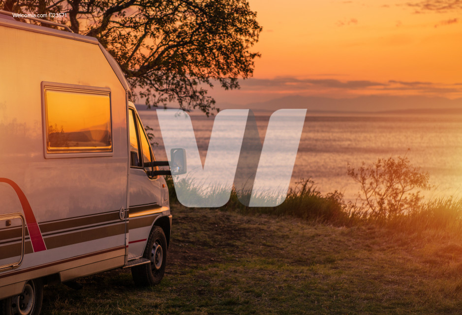 Waterfront RV Camping Site During Scenic Sunset.