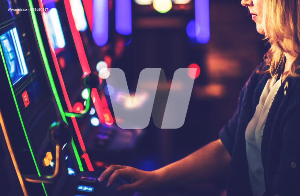 Woman Playing Casino Slot Machine Game