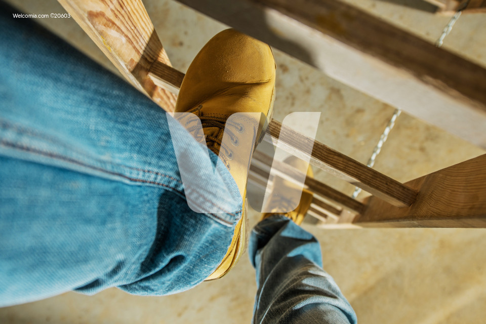 Worker on Wooden Ladder